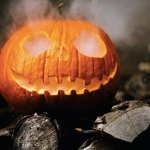 Carved pumpkin with smoke coming out of it's eyes