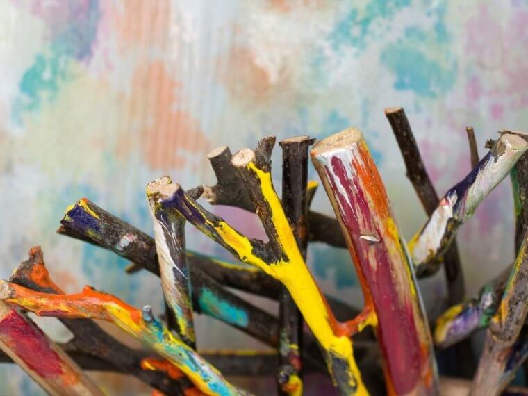 Painted sticks on a coloured background