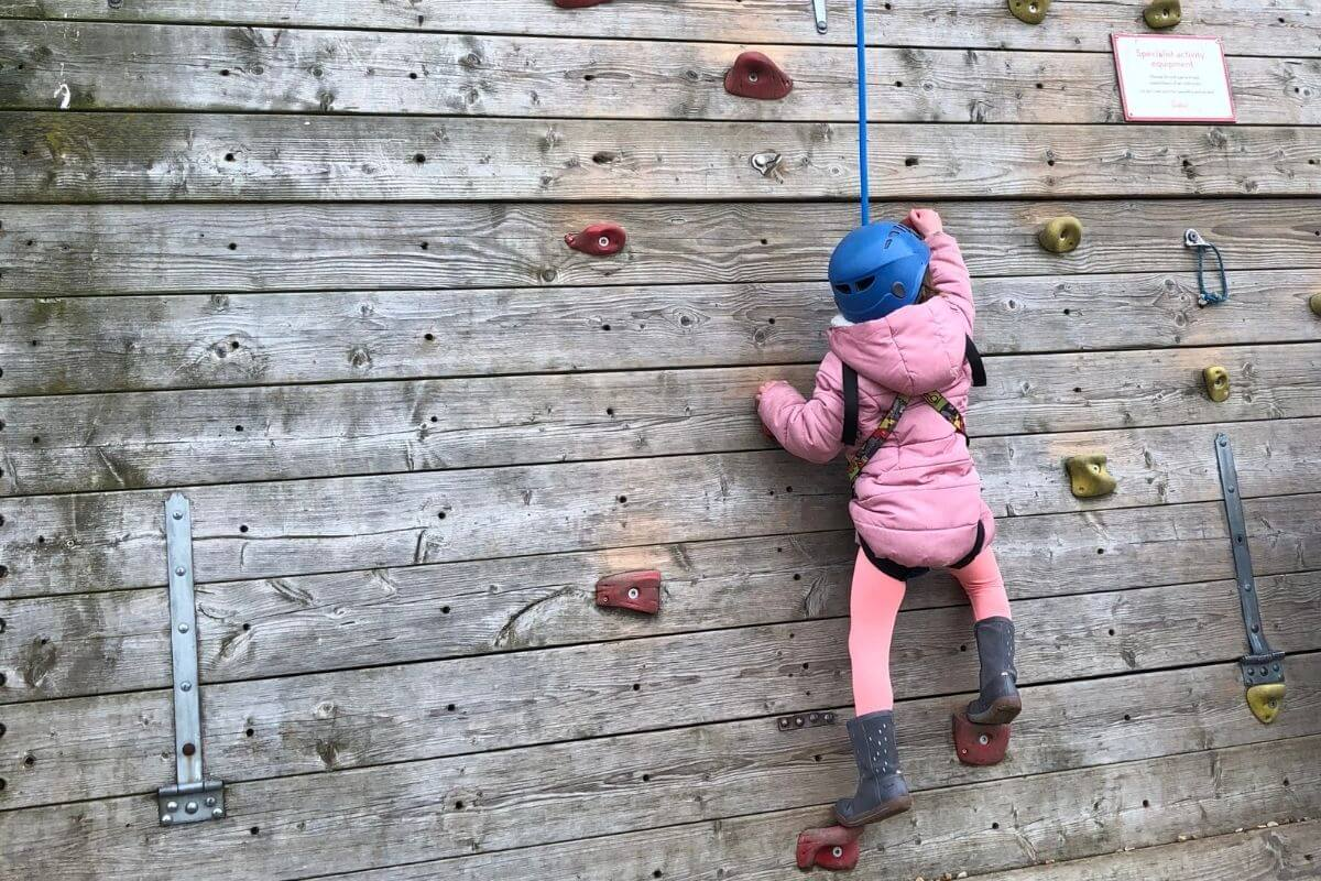 Climbing wall with child climber