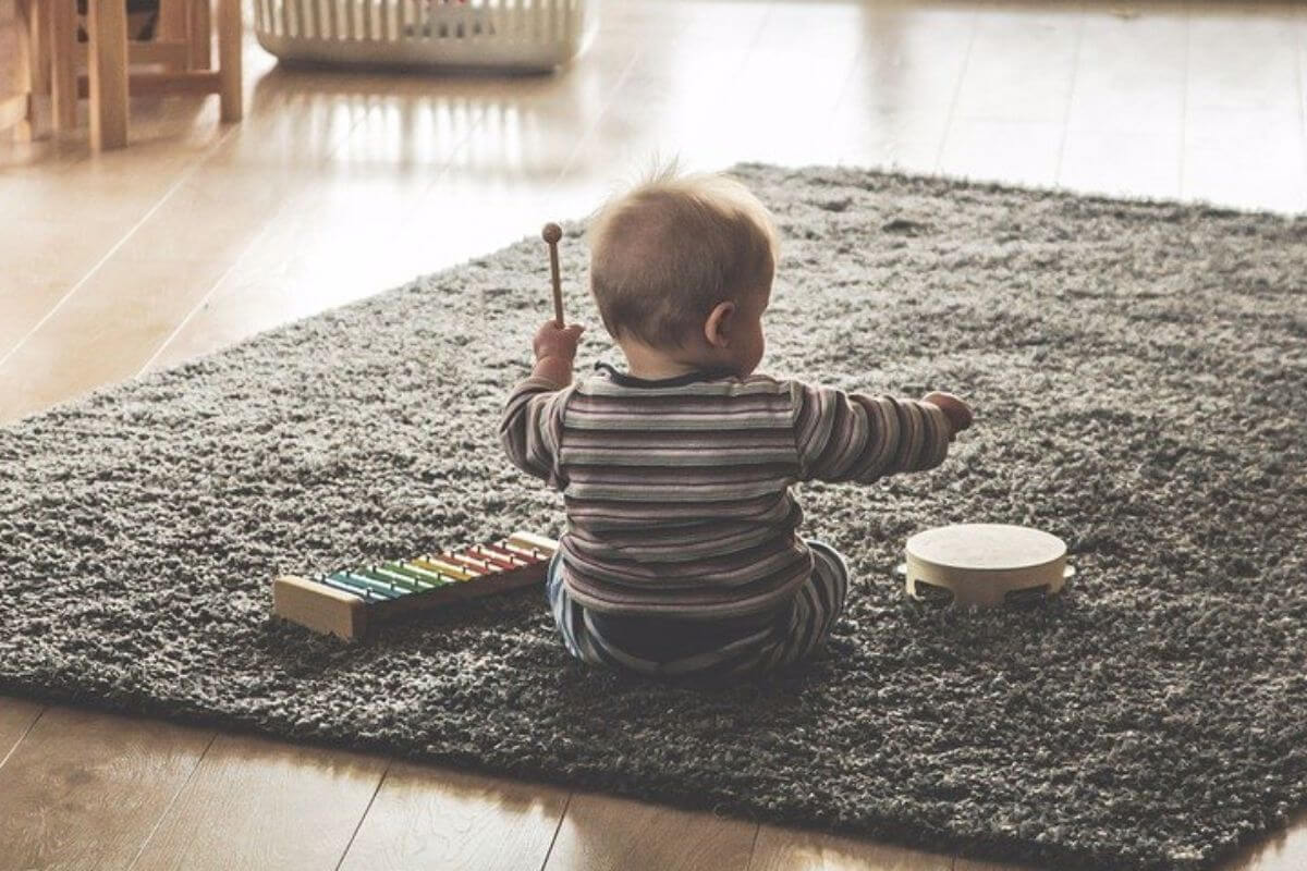 Child playing the drum