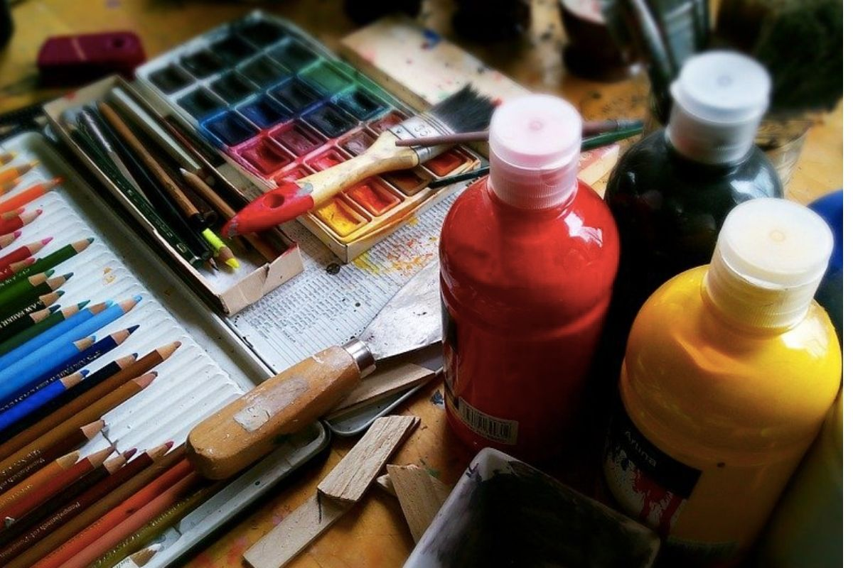 Paint and brushes on a desk